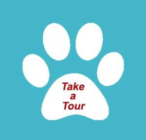 river-dog-inn-white-paw-w-blue-background-and-red-writing-take-a-tour